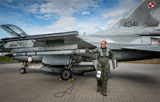 LTC POL AF Paul does his F-16 walkaround inspection before flight in Exercise Brilliant Arrow