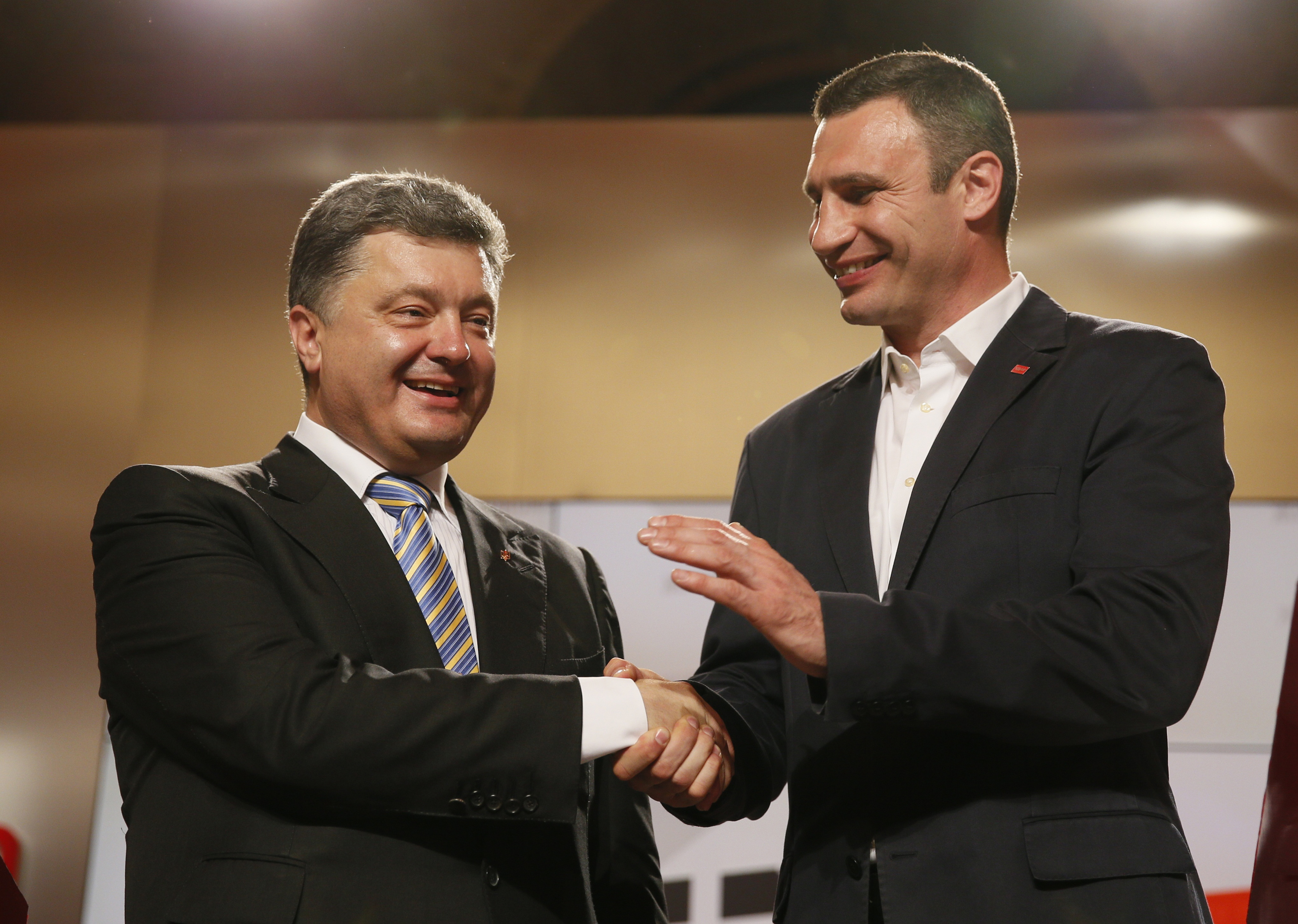 Presidential candidate Petro Poroshenko (left) and Kyiv mayoral candidate Vitali Klitschko celebrate after claiming victory in the May 25 elections. Klitschko withdrew from the presidential race and allied his UDAR party (the Ukrainian Democratic Alliance for Reform) with Poroshenko's candidacy. Both men are seen as centrists. REUTERS/Gleb Garanich