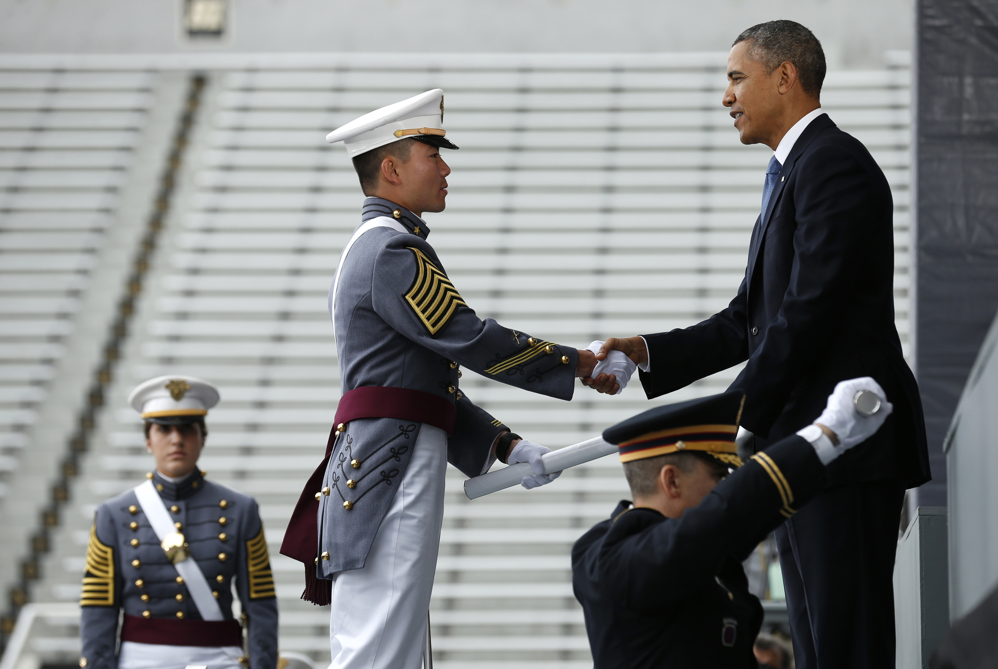 President Barack Obama hands a diploma to one of about 1,000 graduating cadets at the U.S. Military Academy at West Point, New York, on May 28. Obama's commencement address is one of several the White House plans to lay out his foreign policy vision for the remainder of his term in office. REUTERS/Kevin Lamarque