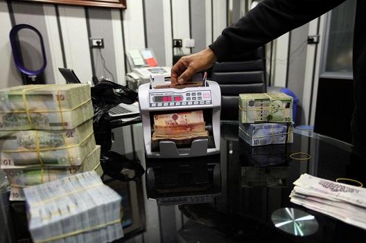 Freeze assets to halt the war in Libya