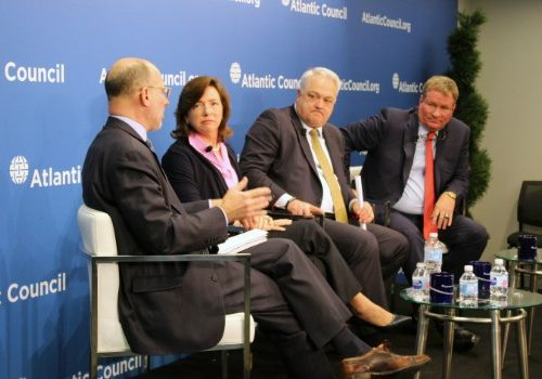 Steve Grundman moderates a panel of industry leaders, including Barbara Humpton of Siemens USA, Andy Hove of AM General, and Brad Feldmann of Cubic Corporation (L-R).