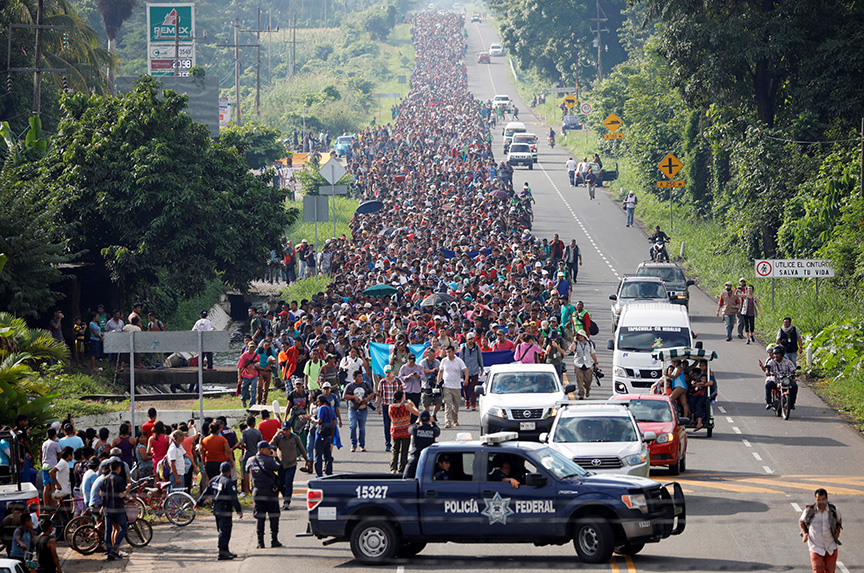 Why is a caravan of Central American migrants fleeing to the United States?