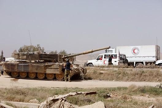 Regime resurgence endangers local aid community