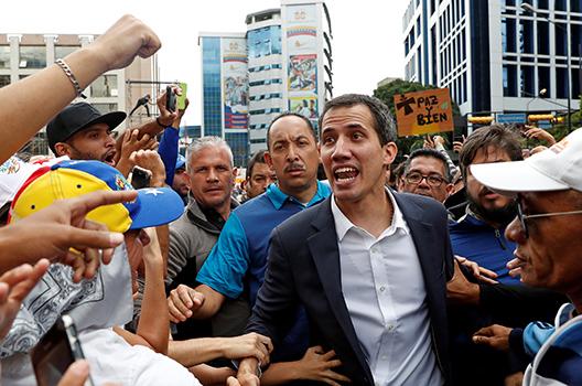 Trump recognizes Venezuelan opposition leader as interim president