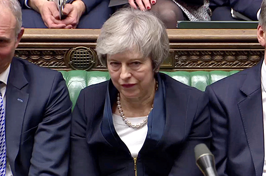 May's Brexit deal stumbles in Parliament. Now she is fighting to save her government.