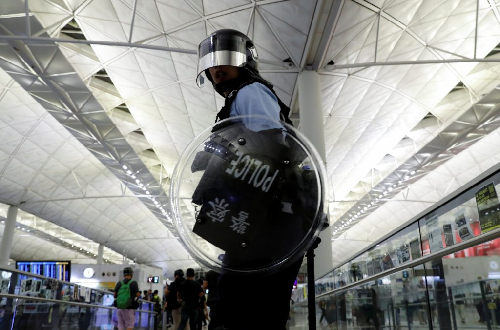 Airport clash raises fear of violent crackdown in Hong Kong