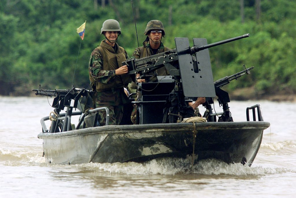 Colombian soldiers patrol aboard a highspeed, armored boat over the Caquetá river during an army training near Tres Esquinas army base. (REUTERS/Daniel Munoz)