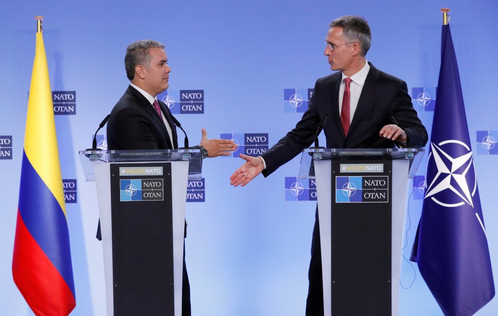 Colombian President Iván Duque shakes hands with NATO Secretary General Jens Stoltenberg after a meeting at the Alliance headquarters in Brussels, Belgium in 2018. Colombia is the first NATO global partner in Latin America. (REUTERS/Yves Herman)