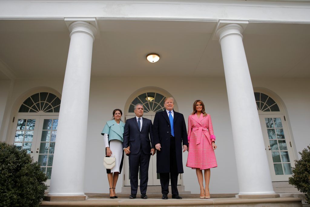 U.S. President Donald Trump and first lady Melania Trump stand with Colombian President Ivan Duque and his wife Maria Juliana Ruiz after their arrival at the White House in Washington, U.S.