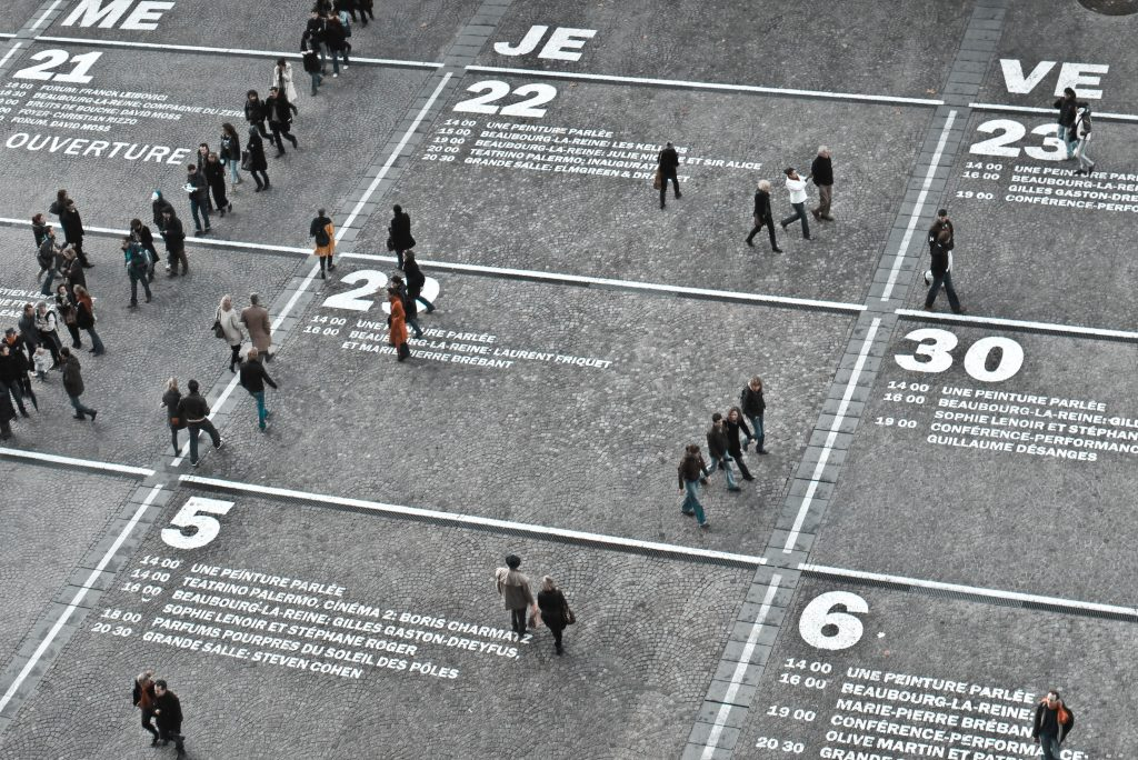 people walking on a road that looks like a calendar during day time