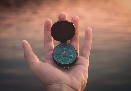 gtc compass in hand to navigate and guide
