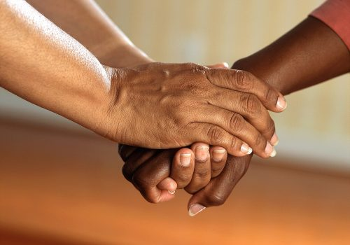 gtc clasped hands together for public good