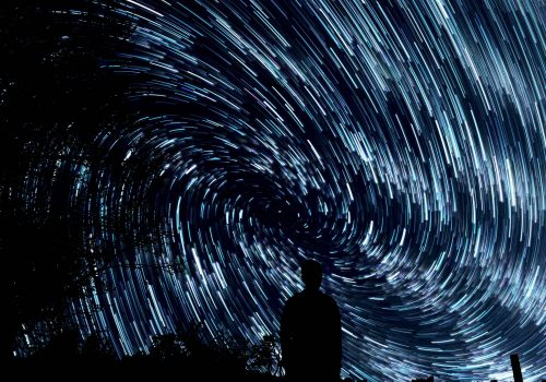 swirling stars like data around a person