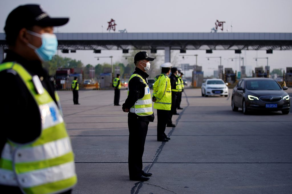 gtc police officers stand guard at a toll station of an expressway in Wuhan