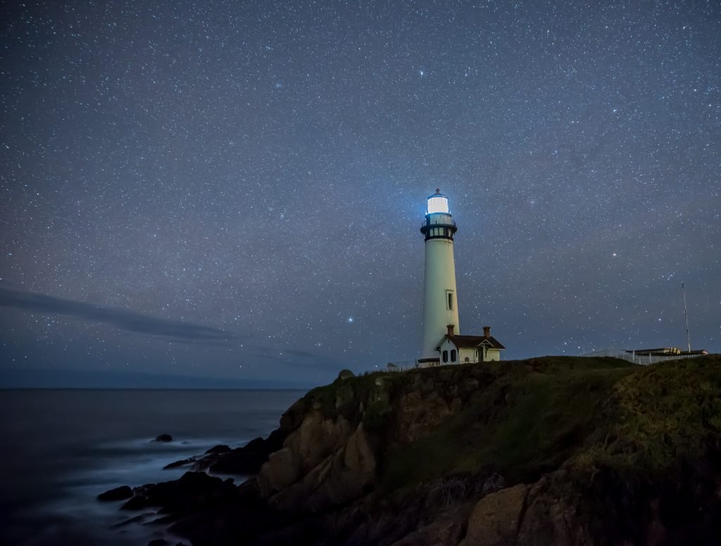 gtc lighthouse shining beacon in the night