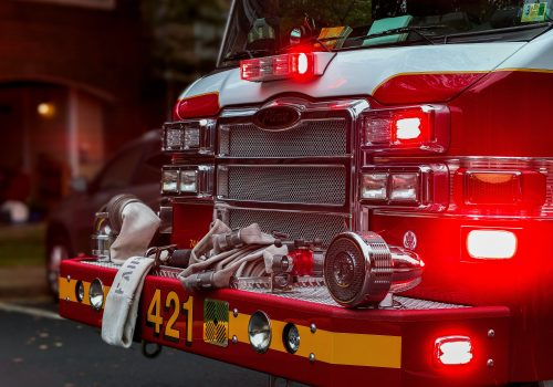gtc front of a fire engine with the lights glowing