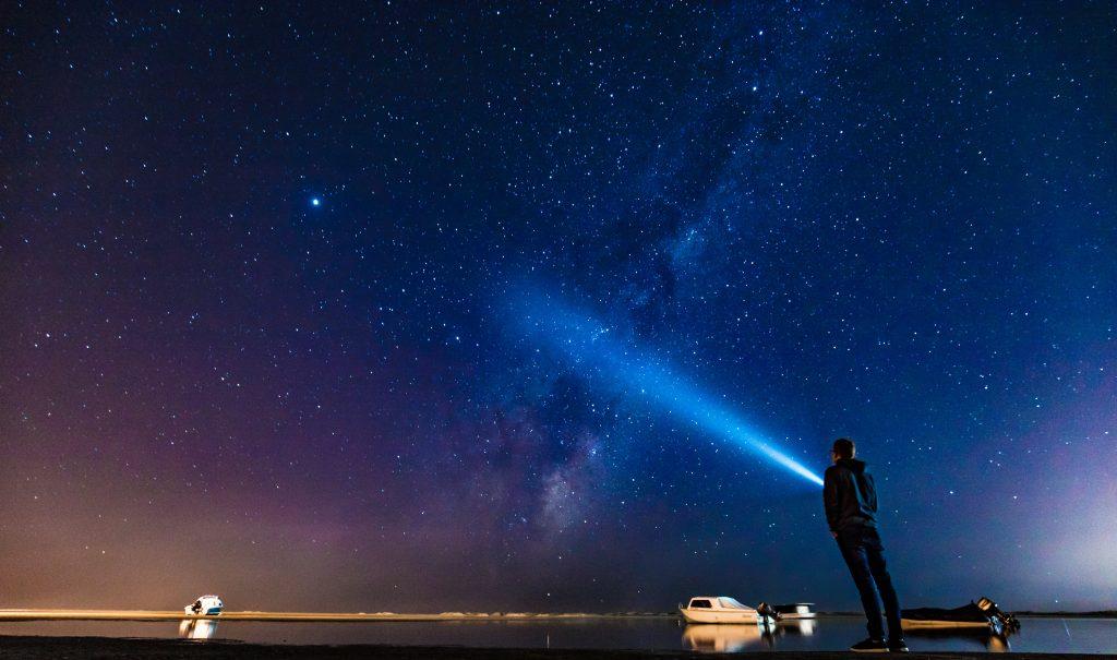 gtc searchlight shining into the night sky