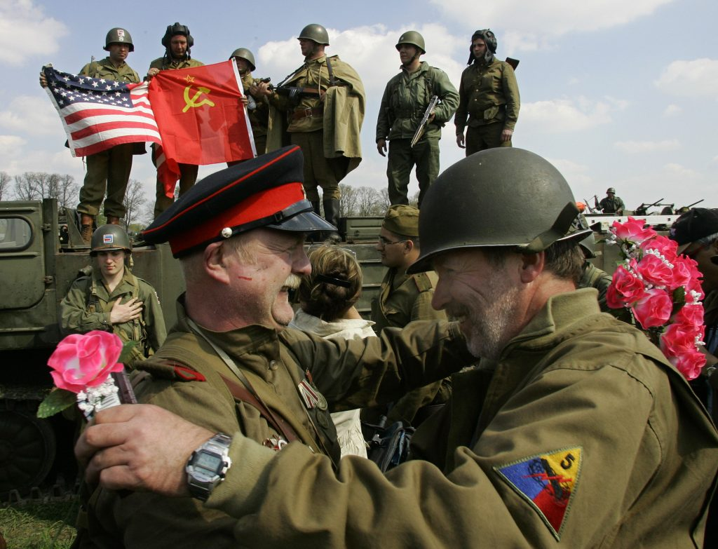 Putin woos Trump with WWII nostalgia but Russia's hybrid war continues
