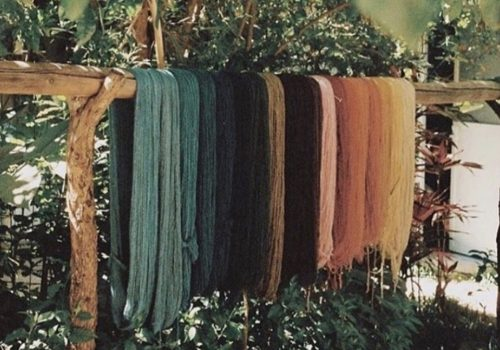 Colorful yarn hanging over a branch