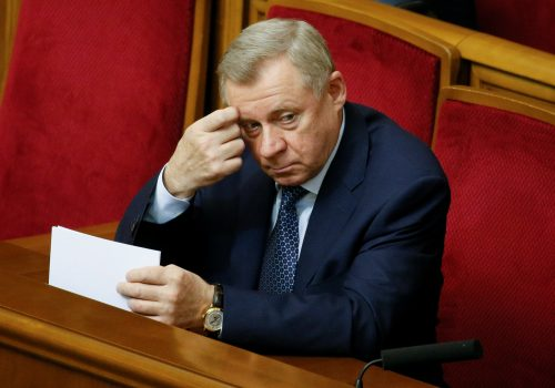 "Analysis: Ukraine's central bank governor quits post citing ""political pressure"""