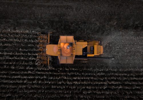 GeoTech Center's work on the Global Food System, image of a tractor in a field of crops