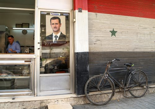 Strapped for dollars, the Syrian government is forcing its citizens to pay up