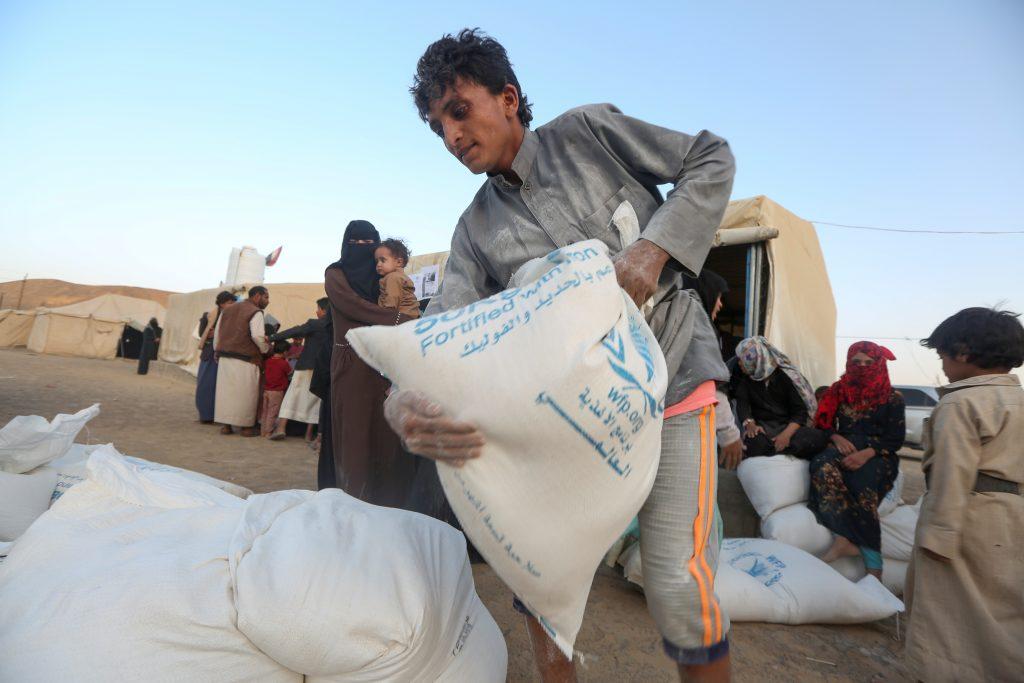 Man carry sack of flour